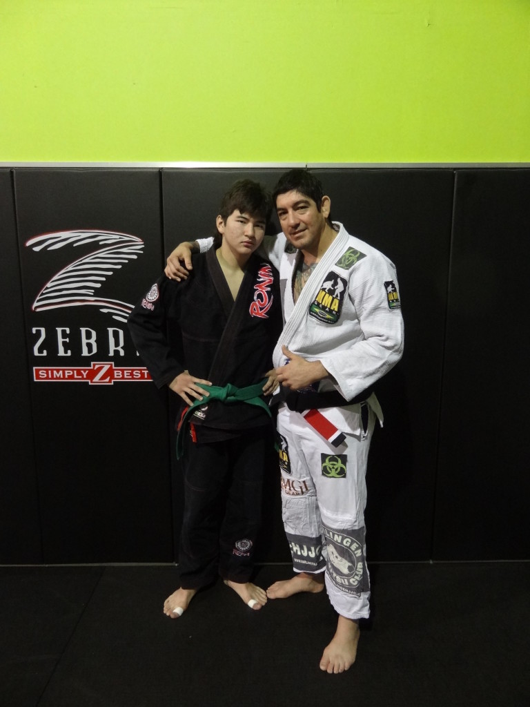 My Brazilian Jiu-Jitsu instructor, Jacob Montalvo and me 12/28/13.